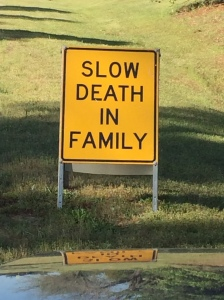 slow death in family highway sign